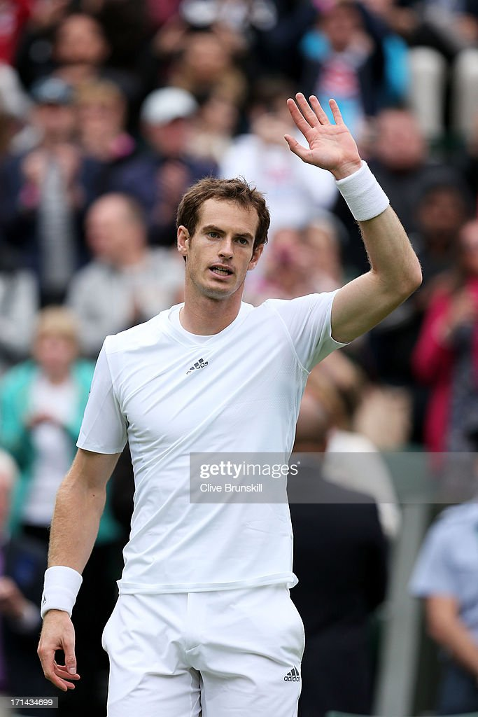 Andy Murray of Great Britain waves to the crowd as he celebrates match point during his Gentlemen's Singles first round match against Benjamin Becker of Germany on day one of the Wimbledon Lawn Tennis Championships at the All England Lawn Tennis and Croquet Club on June 24, 2013 in London, England.