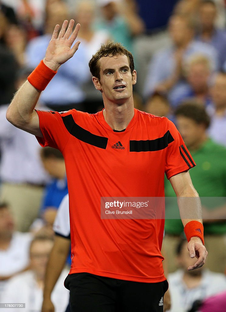 Andy Murray of Great Britain waves to the crowd as he celebrates victory following his men's singles first round match against Michael Llodra of France on Day Three of the 2013 US Open at USTA Billie Jean King National Tennis Center on August 28, 2013 in the Flushing neighborhood of the Queens borough of New York City.