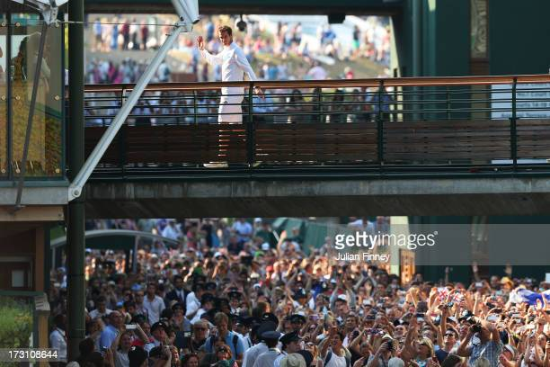 Andy Murray of Great Britain waves to the waiting crowd outside Centre Court following his victory in the Gentlemen's Singles Final match against...