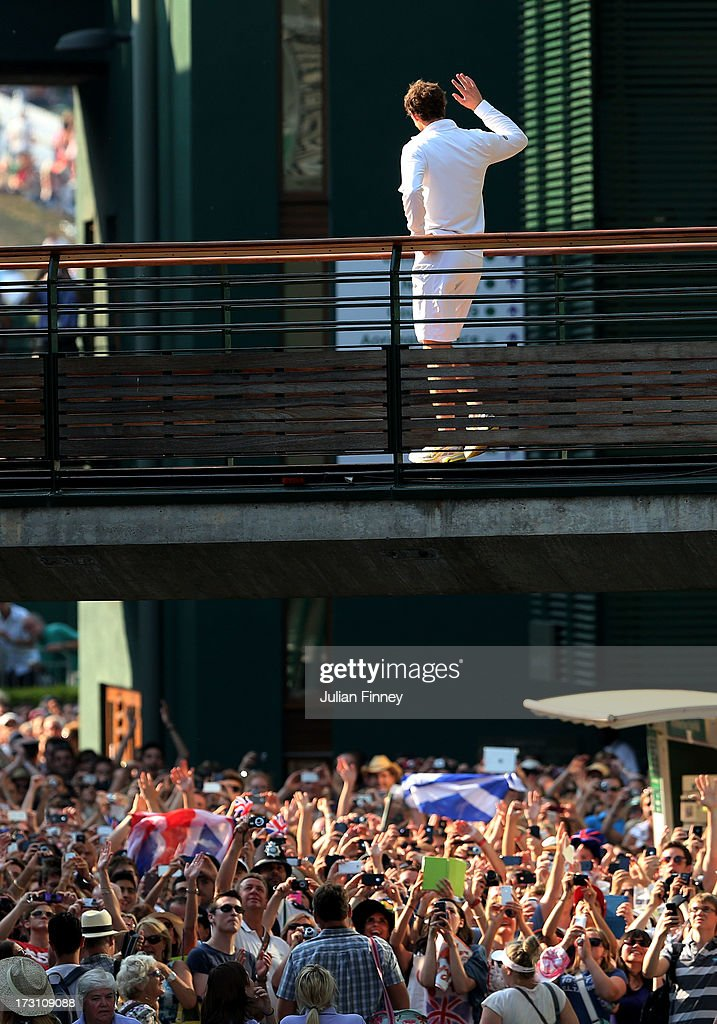 Andy Murray of Great Britain waves to the waiting crowd outside Centre Court following his victory in the Gentlemen's Singles Final match against Novak Djokovic of Serbia on day thirteen of the Wimbledon Lawn Tennis Championships at the All England Lawn Tennis and Croquet Club on July 7, 2013 in London, England.