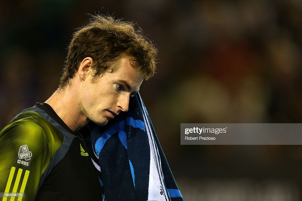 Andy Murray of Great Britain wipes his face with a towel in his semifinal match against Roger Federer of Switzerland during day twelve of the 2013 Australian Open at Melbourne Park on January 25, 2013 in Melbourne, Australia.