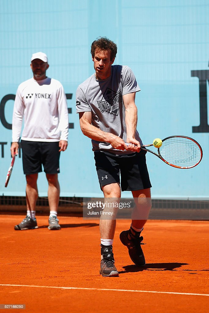 <a gi-track='captionPersonalityLinkClicked' href=/galleries/search?phrase=Andy+Murray+-+Tennis+Player&family=editorial&specificpeople=200668 ng-click='$event.stopPropagation()'>Andy Murray</a> of Great Britain with <a gi-track='captionPersonalityLinkClicked' href=/galleries/search?phrase=Jamie+Delgado&family=editorial&specificpeople=235586 ng-click='$event.stopPropagation()'>Jamie Delgado</a> on the practice court during day three of the Mutua Madrid Open tennis tournament at the Caja Magica on May 02, 2016 in Madrid, Spain.