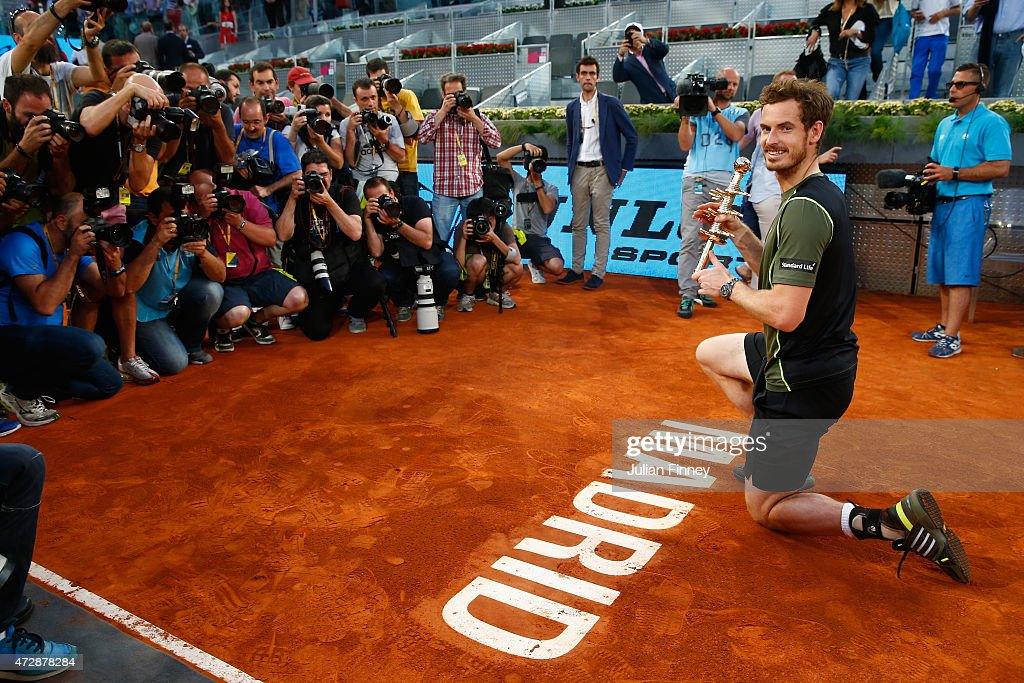 Andy Murray of Great Britain with the winners trophy by the court logo after his win over Rafael Nadal of Spain in the final during day nine of the Mutua Madrid Open tennis tournament at the Caja Magica on May 10, 2015 in Madrid, Spain.