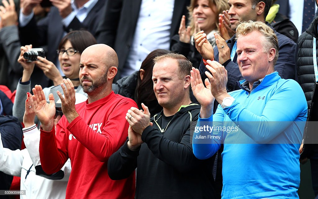 Andy Murray of Great Britain's coaching team of Jamie Delgado, Matt Little and Mark Bender applaud his victory during the Men's Singles first round match victory against Radek Stepanek of the Czech Republic on day three of the 2016 French Open at Roland Garros on May 24, 2016 in Paris, France.