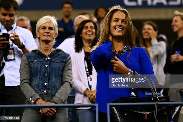 Andy Murray of Great Britain's girlfriend Kim Sears and his mother Judy Murray attend his men's singles fourth round match against Denis Istomin of...