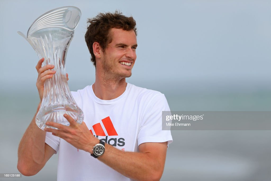 Andy Murray of Great Brittain poses on the beach at Key Biscayne after winning the final of the Sony Open against David Ferrer of Spain at Crandon Park Tennis Center on March 31, 2013 in Key Biscayne, Florida.