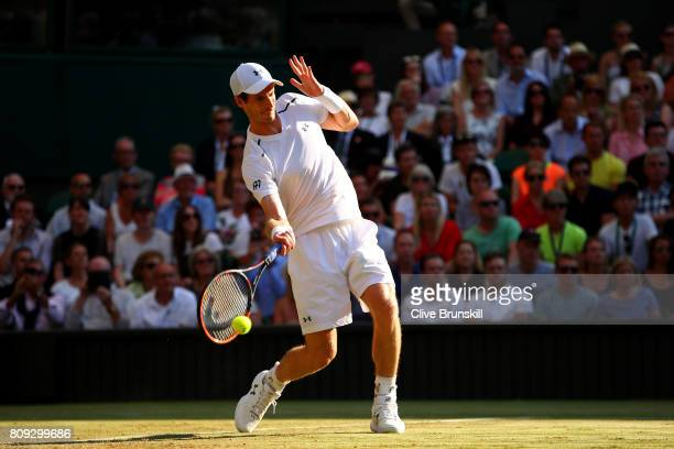 Andy Murray of Great plays a forehand during the Gentlemen's Singles second round match against Dustin Brown of Germany on day three of the Wimbledon...
