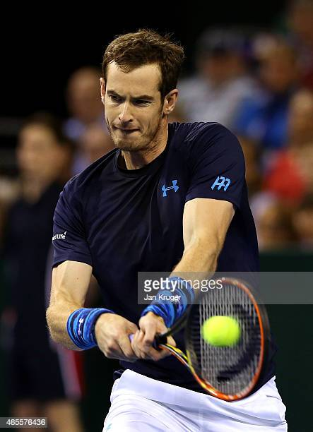 Andy Murray of The Aegon GB Davis Cup Team plays a return shot in his match against John Isner of the United States during Day 3 of the Davis Cup...