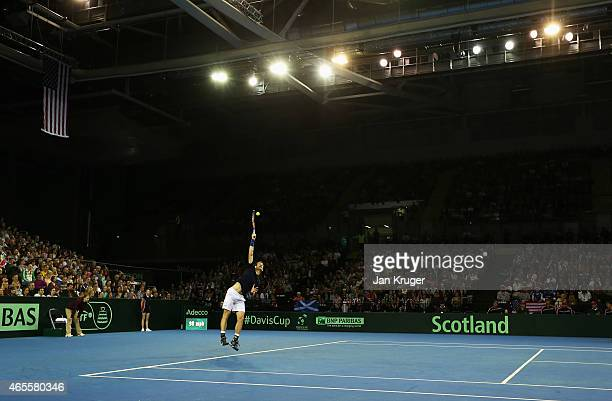 Andy Murray of The Aegon GB Davis Cup Team serves in his singles match against John Isner of the United States during day 3 of the Davis Cup match...