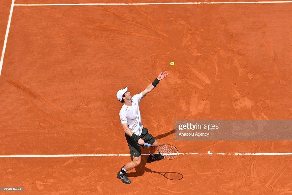 Andy Murray of United Kingdom serves to Ivo Karlovic (not seen) of Croatia during the men's single third round match at the French Open tennis tournament at Roland Garros Stadium in Paris, France on May 27, 2016.