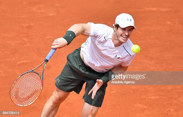 Andy Murray of United Kingdom serves to Ivo Karlovic of Croatia during the men's single third round match at the French Open tennis tournament at...