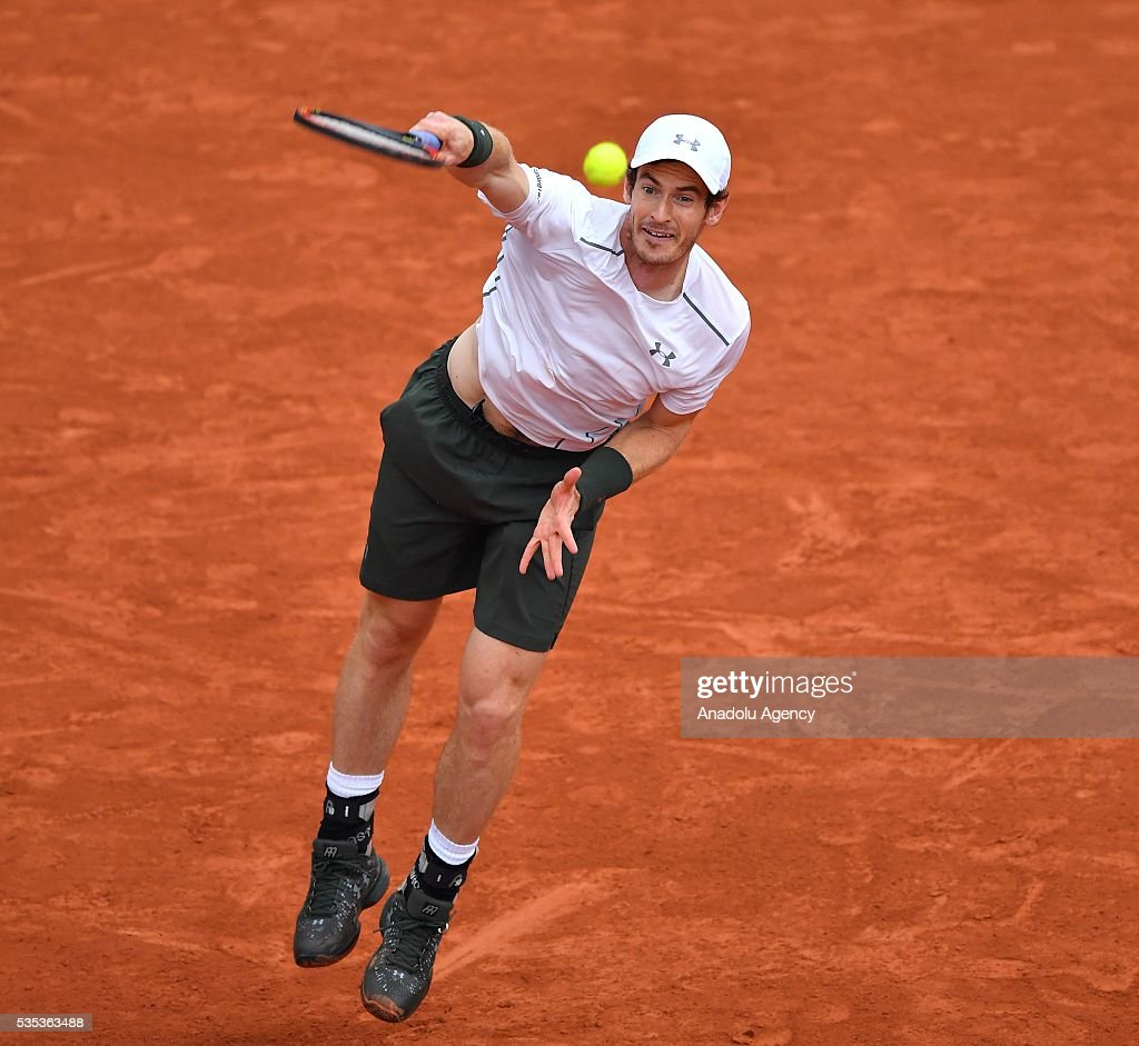 Andy Murray of United Kingdom serves to John Isner of US during the men's single fourth round match at the French Open tennis tournament at Roland Garros Stadium in Paris, France on May 29, 2016.