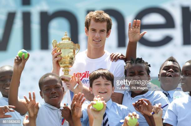 Andy Murray poses with Year 6 pupils from St Marks Church of England Primary School in Kennington during an Adidas sponsored #hitthewinner event at...