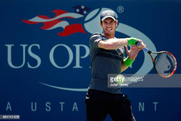 Andy Murray returns a shot against Robin Haase of the Netherlands on Day One of the 2014 US Open at the USTA Billie Jean King National Tennis Center...
