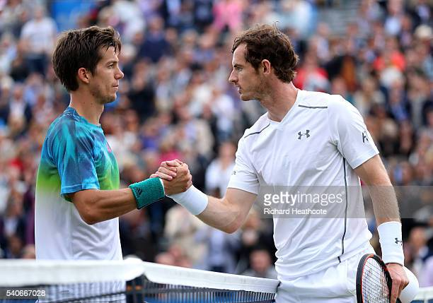 Andy Murray shakes hands with Aljaz Bedene after winning their second round match during day four of The Aegon Championships at The Queens Club on...