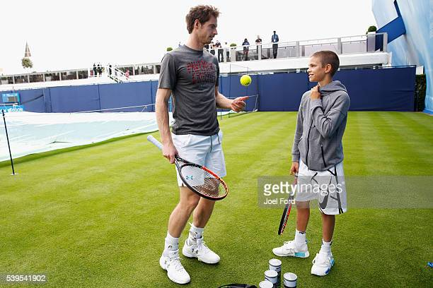 Andy Murray speaks with Romeo Beckham the son of formr footballer David Beckham after the pair hit a few balls prior to Murray's practice session at...