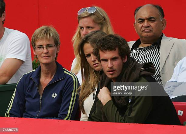 Andy Murray watches his brother Jamie in action alongside girlfriend Kim Sears and mother Judy Murray during the doubles first round match between...