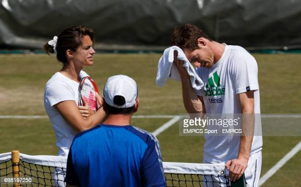 Andy Murray wipes his brow during hs practice session watched over by coach Amelie Mauresmo