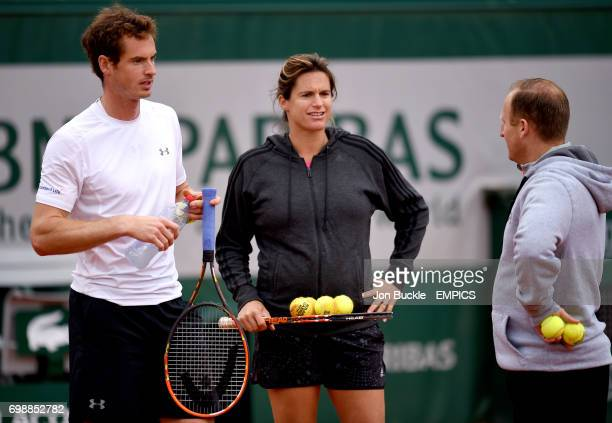 Andy Murray with coach Amelie Mauresmo and trainer Mark Little during practice on day ten of the French Open at Roland Garros on June 2 2015 in Paris...