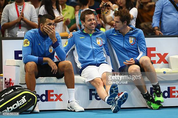Andy MurrayJoWilfried Tsonga and Daniel Nestor of the Manila Mavericks sit on the team bench during one of the teams series of matches at the...