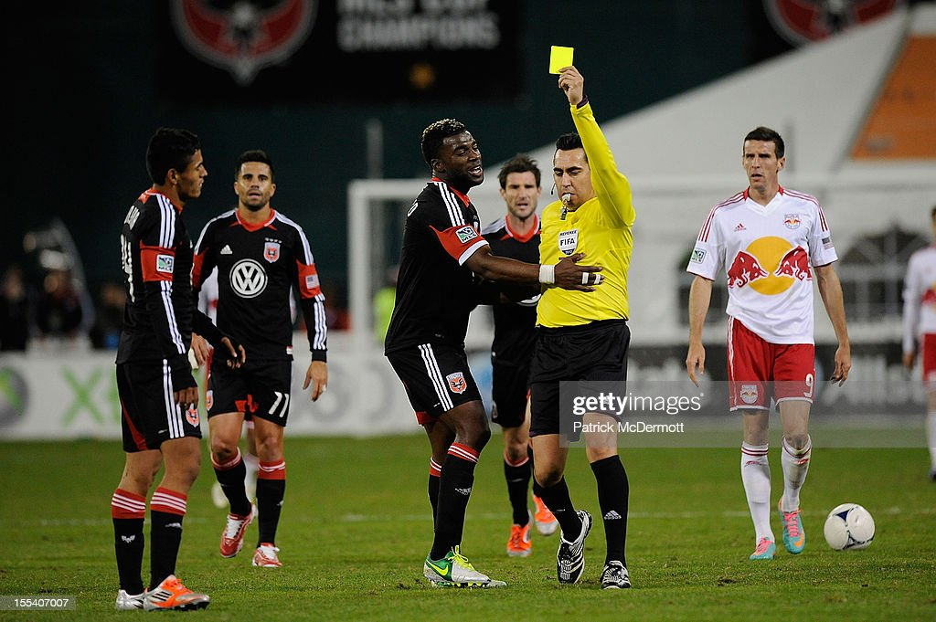 <a gi-track='captionPersonalityLinkClicked' href=/galleries/search?phrase=Andy+Najar&family=editorial&specificpeople=6872158 ng-click='$event.stopPropagation()'>Andy Najar</a> #14 of D.C. United is shown a second yellow card by referee Jair Marrufo in the second half against the New York Red Bulls during their Eastern Conference Semifinal match at RFK Stadium on November 3, 2012 in Washington, DC.