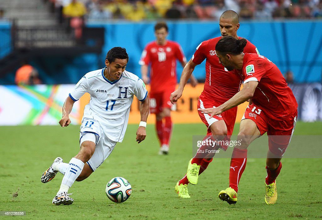 Andy Najar of Honduras controsl the ball as Ricardo Rodriguez of Switzerland gives chase during the 2014 FIFA World Cup Brazil Group E match between Honduras and Switzerland at Arena Amazonia on June 25, 2014 in Manaus, Brazil.