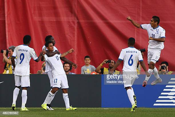 Andy Najar of Honduras second from left celebrates with teammates after scoring a penalty kick goal during the 2015 CONCACAF Gold Cup match between...