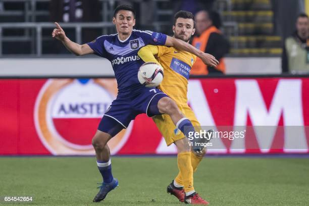 Andy Najar of RSC Anderlecht David Barral of Apoel FCduring the UEFA Europa League round of 16 match between RSC Anderlecht and APOEL on March 16...