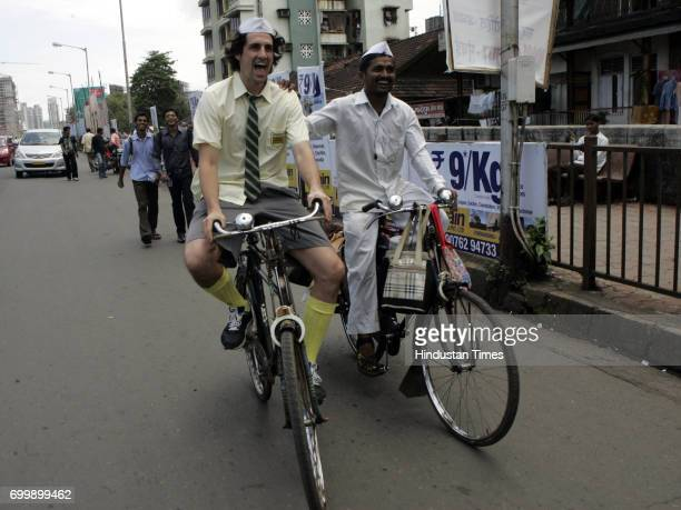 Andy of the famous Hamish and Andy who are anchors of the famous and humourous talk show on the Lower Parel bridge with a dabbawala