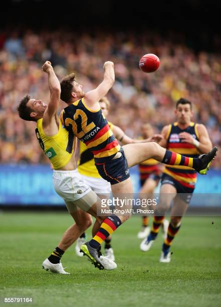 Andy Otten of the Crows is challenged by Alex Rance of the Tigers during the 2017 AFL Grand Final match between the Adelaide Crows and the Richmond...