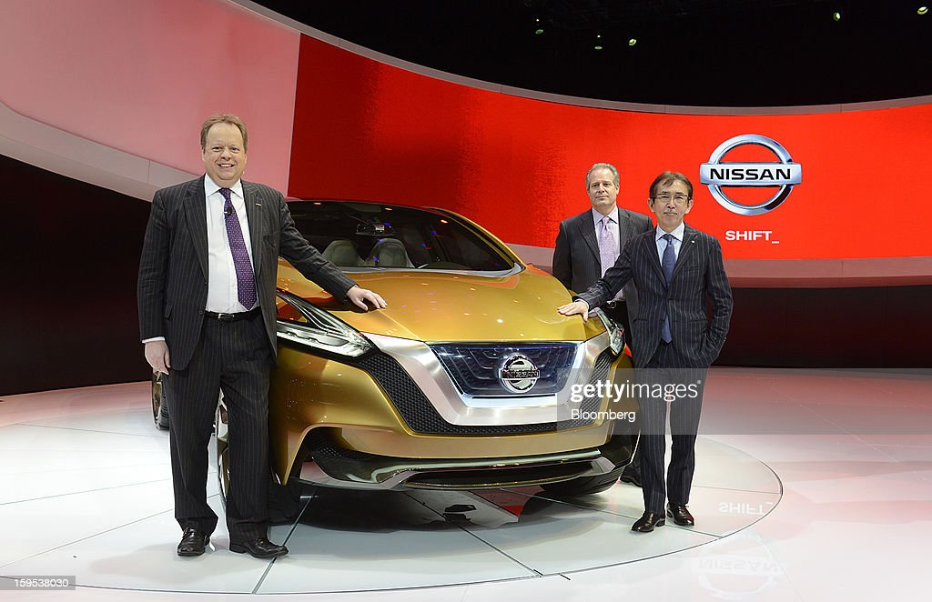 Andy Palmer, executive vice president of Nissan Motor Co., from left, Al Castignetti, vice president and general manager of Nissan North America Inc., and Shiro Nakamura, senior vice president of Nissan Motor Co., stand for a photograph in front of the Resonance concept sports utility vehicle (SUV) during the 2013 North American International Auto Show (NAIAS) in Detroit, Michigan, U.S., on Tuesday, Jan. 15, 2013. The Detroit auto show runs through Jan. 27 and will display over 500 vehicles, representing the most innovative designs in the world. Photographer: David Paul Morris/Bloomberg via Getty Images