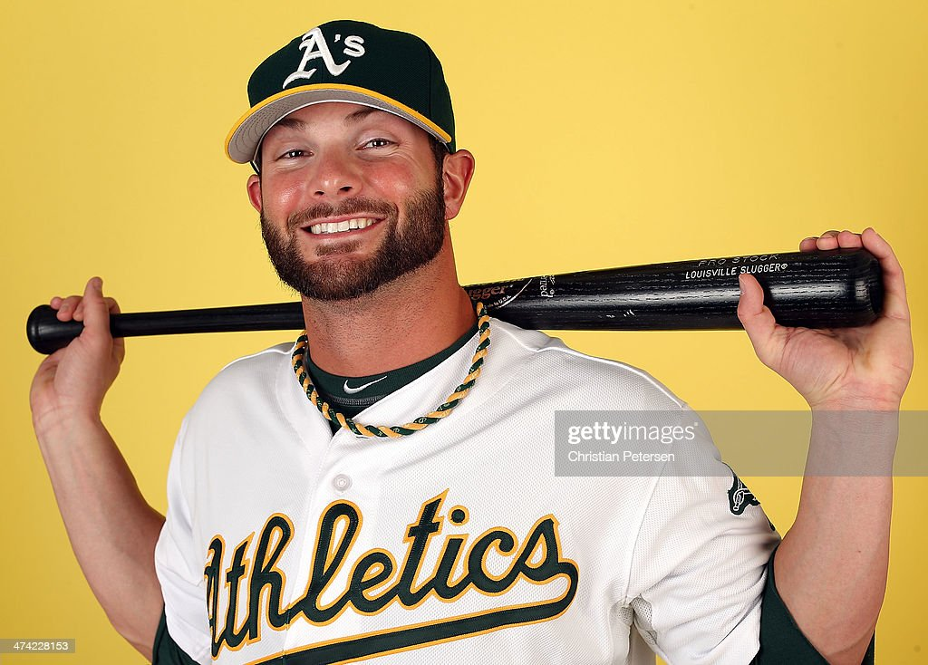 Andy Parrino #12 of the Oakland Athletics poses for a portrait during the spring training photo day at Phoenix Municipal Stadium on February 22, 2014 in Phoenix, Arizona.