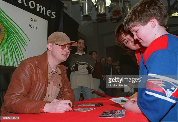 Andy Partridge of the pop duo ATC signs an autograph for fan Jake Bissaro of Swansea during a visit at the Tower Records store on Newbury Street in...