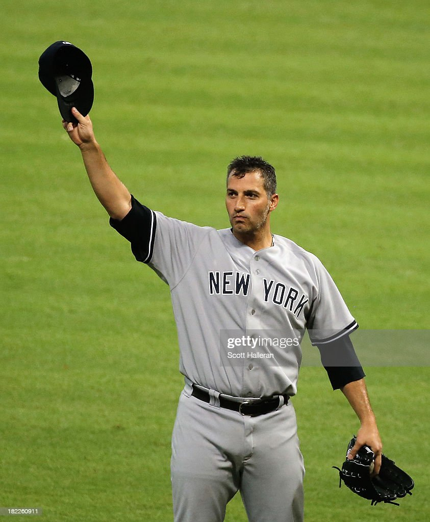 <a gi-track='captionPersonalityLinkClicked' href=/galleries/search?phrase=Andy+Pettitte&family=editorial&specificpeople=201753 ng-click='$event.stopPropagation()'>Andy Pettitte</a> #46 of the New York Yankees celebrates after pitching his last game and defeating the Houston Astros 2-1 at Minute Maid Park on September 28, 2013 in Houston, Texas.