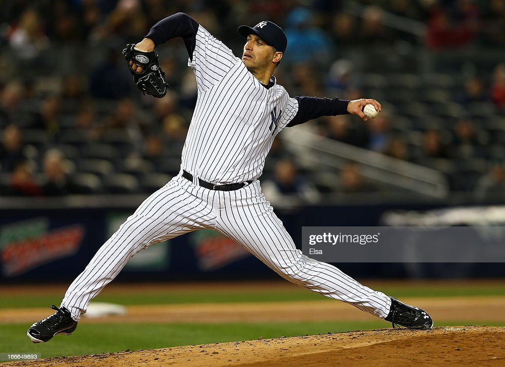 <a gi-track='captionPersonalityLinkClicked' href=/galleries/search?phrase=Andy+Pettitte&family=editorial&specificpeople=201753 ng-click='$event.stopPropagation()'>Andy Pettitte</a> #46 of the New York Yankees delivers a pitch against the Boston Red Sox on April 4, 2013 at Yankee Stadium in the Bronx borough of New York City.