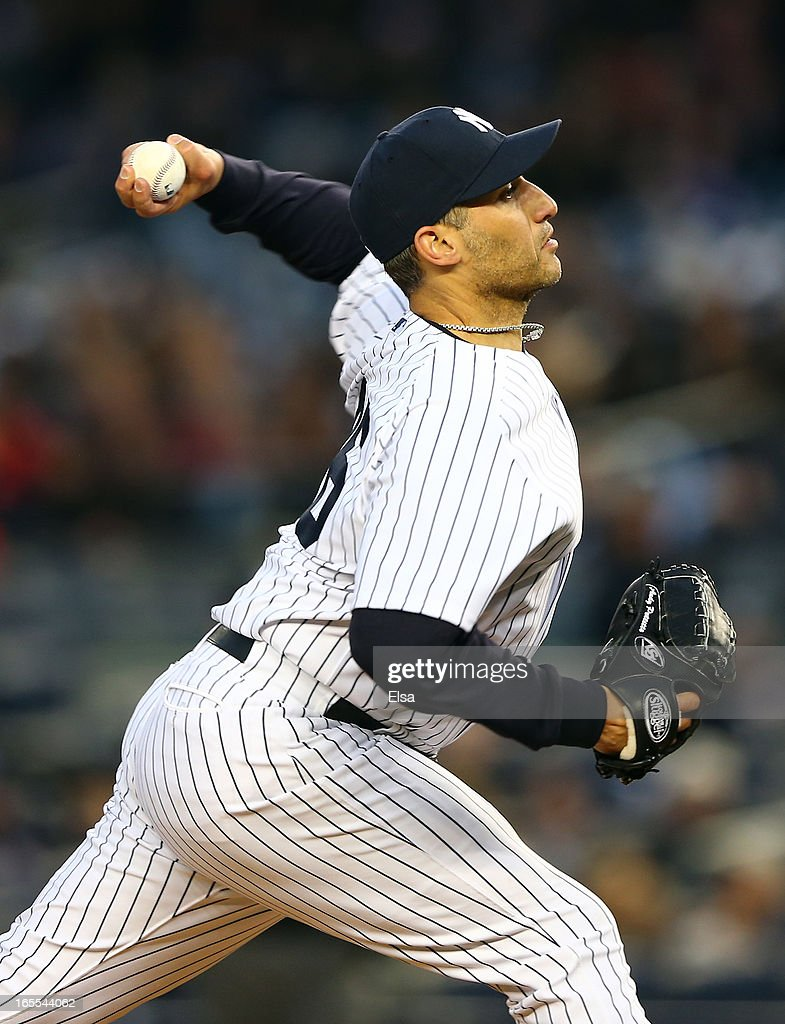 Andy Pettitte #46 of the New York Yankees delivers a pitch in the first inning against the Boston Red Sox on April 4, 2013 at Yankee Stadium in the Bronx borough of New York City.