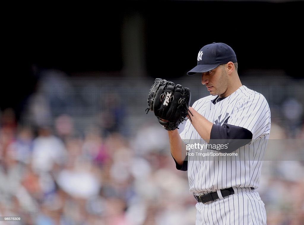 <a gi-track='captionPersonalityLinkClicked' href=/galleries/search?phrase=Andy+Pettitte&family=editorial&specificpeople=201753 ng-click='$event.stopPropagation()'>Andy Pettitte</a> #46 of the New York Yankees looks for a sign from his catcher against the Texas Rangers at Yankee Stadium on April 18, 2010 in the Bronx borough of Manhattan. The Yankees defeated the Rangers 5 - 2.