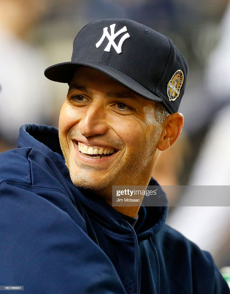 <a gi-track='captionPersonalityLinkClicked' href=/galleries/search?phrase=Andy+Pettitte&family=editorial&specificpeople=201753 ng-click='$event.stopPropagation()'>Andy Pettitte</a> #46 of the New York Yankees looks on from the dugout against the Tampa Bay Rays at Yankee Stadium on September 26, 2013 in the Bronx borough of New York City. The Rays defeated the Yankees 4-0.