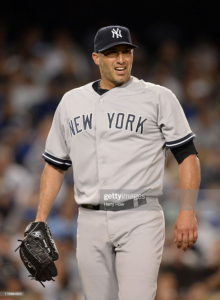 <a gi-track='captionPersonalityLinkClicked' href=/galleries/search?phrase=Andy+Pettitte&family=editorial&specificpeople=201753 ng-click='$event.stopPropagation()'>Andy Pettitte</a> #46 of the New York Yankees reacts as he comes off the mound after the third out in the fifth inning against the Los Angeles Dodgers at Dodger Stadium on July 30, 2013 in Los Angeles, California.