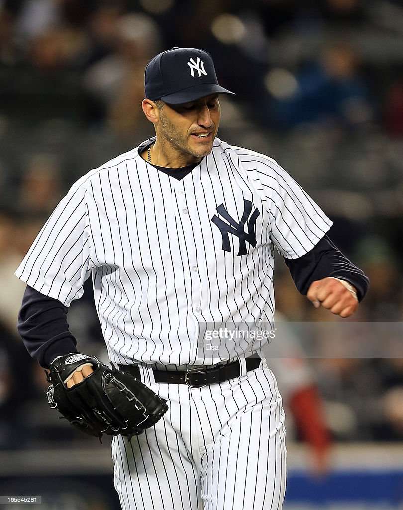 <a gi-track='captionPersonalityLinkClicked' href=/galleries/search?phrase=Andy+Pettitte&family=editorial&specificpeople=201753 ng-click='$event.stopPropagation()'>Andy Pettitte</a> #46 of the New York Yankees reacts to the final out of the eighth inning against the Boston Red Sox n April 4, 2013 at Yankee Stadium in the Bronx borough of New York City.