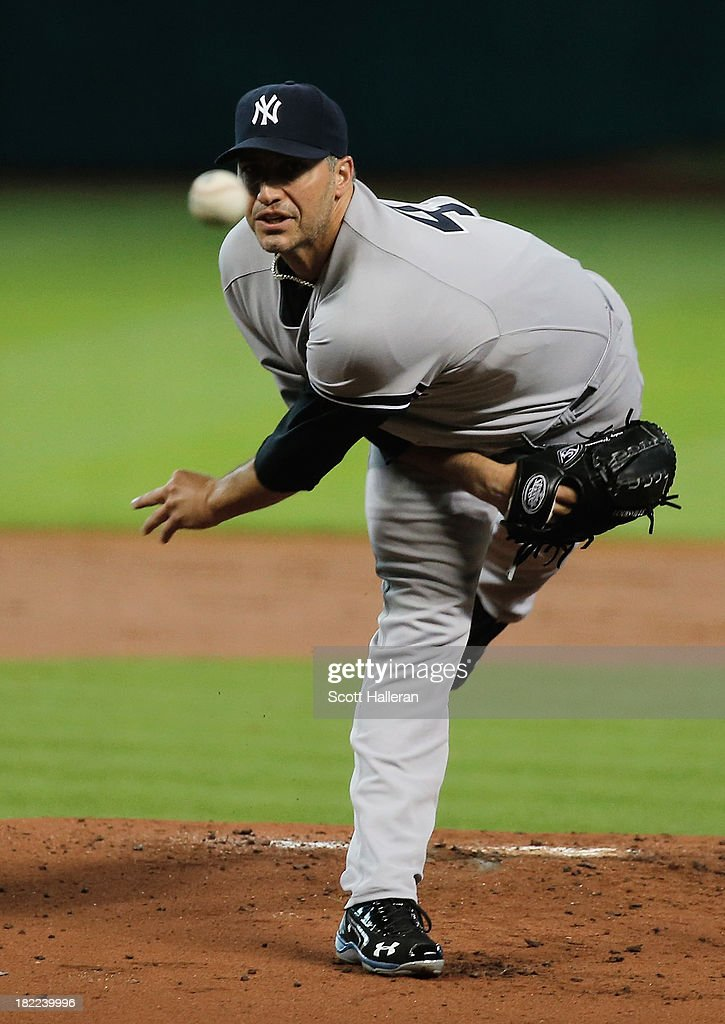 <a gi-track='captionPersonalityLinkClicked' href=/galleries/search?phrase=Andy+Pettitte&family=editorial&specificpeople=201753 ng-click='$event.stopPropagation()'>Andy Pettitte</a> #46 of the New York Yankees throws a pitch in the first inning against the Houston Astros at Minute Maid Park on September 28, 2013 in Houston, Texas.