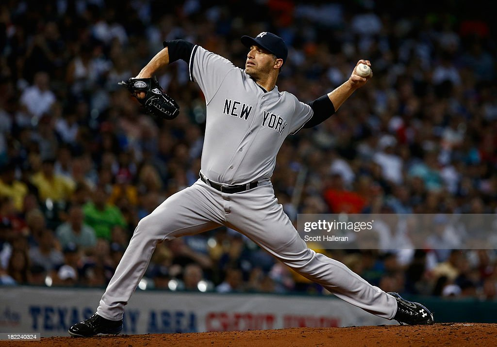 <a gi-track='captionPersonalityLinkClicked' href=/galleries/search?phrase=Andy+Pettitte&family=editorial&specificpeople=201753 ng-click='$event.stopPropagation()'>Andy Pettitte</a> #46 of the New York Yankees throws a pitch in the second inning against the Houston Astros at Minute Maid Park on September 28, 2013 in Houston, Texas.