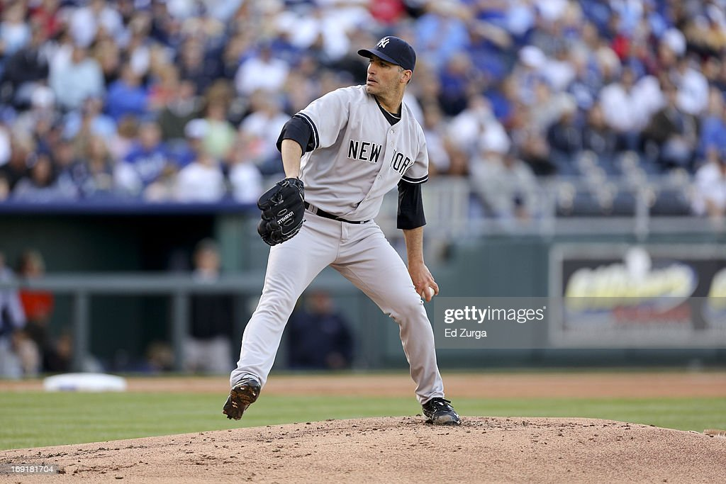 <a gi-track='captionPersonalityLinkClicked' href=/galleries/search?phrase=Andy+Pettitte&family=editorial&specificpeople=201753 ng-click='$event.stopPropagation()'>Andy Pettitte</a> #46 of the New York Yankees throws during a game against the Kansas City Royals at Kauffman Stadium on May 11, 2013 in Kansas City, Missouri.
