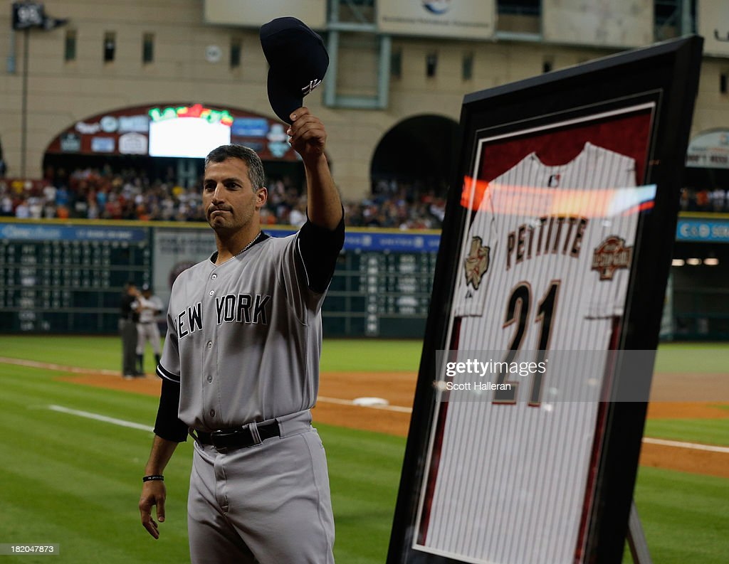 <a gi-track='captionPersonalityLinkClicked' href=/galleries/search?phrase=Andy+Pettitte&family=editorial&specificpeople=201753 ng-click='$event.stopPropagation()'>Andy Pettitte</a> #46 of the New York Yankees waves to the crowd after he was given an Astros jersey by the team during the fifth inning of the game against the Houston Astros at Minute Maid Park on September 27, 2013 in Houston, Texas.