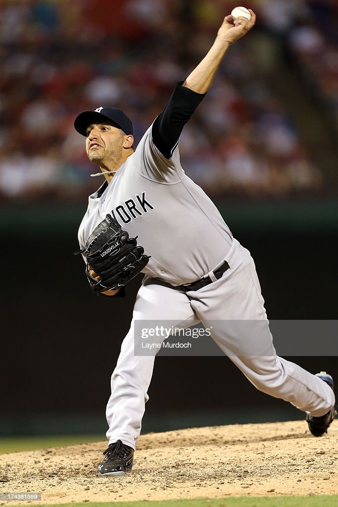 <a gi-track='captionPersonalityLinkClicked' href=/galleries/search?phrase=Andy+Pettitte&family=editorial&specificpeople=201753 ng-click='$event.stopPropagation()'>Andy Pettitte</a> #46, starting pitcher for the New York Yankees pitches against the Texas Rangers on July 24, 2013 at the Rangers Ballpark in Arlington in Arlington, Texas.