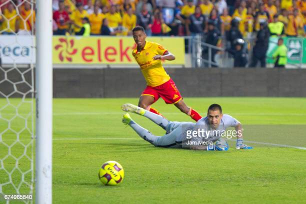 Andy Polo of Morelia scores his taem's second goal past Alfredo Saldivar of Pumas during the 16th round match between Morelia and Pumas as part of...
