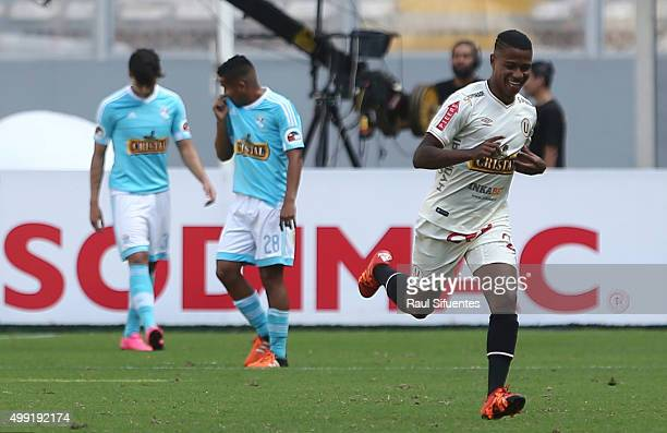Andy Polo of Universitario celebrates after scoring the first goal of his team against Sporting Cristal during a match between Sporting Cristal and...