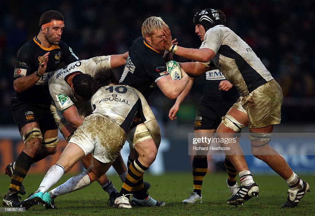 Andy Powell of Wasps is tackled by <a gi-track='captionPersonalityLinkClicked' href=/galleries/search?phrase=Patricio+Albacete&family=editorial&specificpeople=2516588 ng-click='$event.stopPropagation()'>Patricio Albacete</a> and <a gi-track='captionPersonalityLinkClicked' href=/galleries/search?phrase=David+Skrela&family=editorial&specificpeople=596534 ng-click='$event.stopPropagation()'>David Skrela</a> of Toulouse during the Heineken Cup pool 6 match between London Wasps and Toulouse at Adams Park on January 23, 2011 in High Wycombe, England.