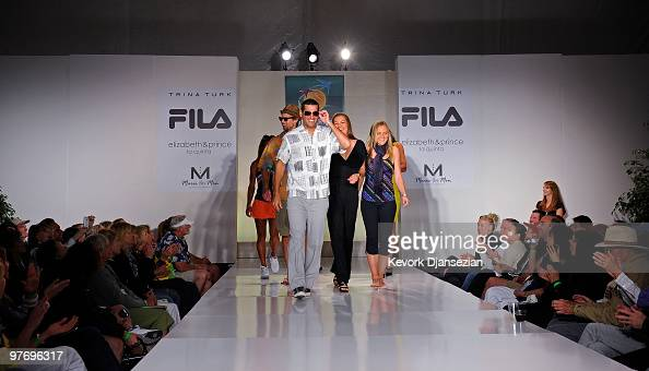 Andy Ram leads fellow tennis players down the runway after they participated in a fashion show during the BNP Paribas Open on March 13 2010 in Indian...