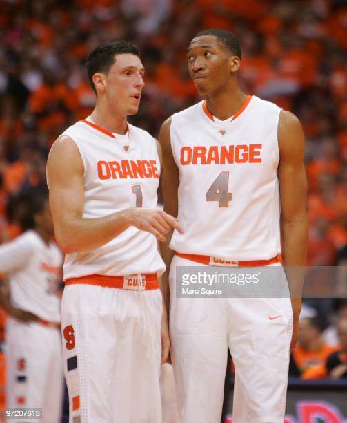 Andy Rautnis and Wesley Johnson of the Syracuse Orange talk during a timeout during the game against the Villanova Wildcats at the Carrier Dome on...